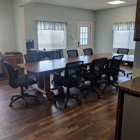 Photo Of An Office Floor And Table Cleaned By American Team Cleaning Solutions.